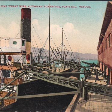 This postcard image, dating from circa 1920, shows a cargo ship being loaded with wheat at the Port of Portland.