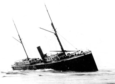The stranded S.S. Yaquina City wallowing on the beach north of the Yaquina Bay entrance.