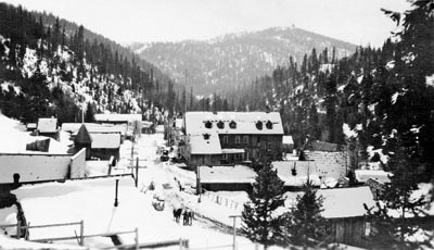 A snow-dusted scene of downtown Bourne in 1921, a view from the front porch of White's mansion