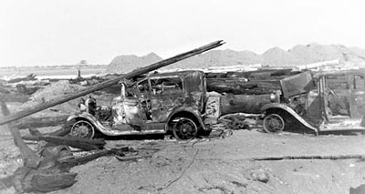 Burned-out cars on the beach after the 1936 Bandon fire