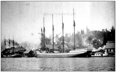 Four-masted schooner Admiral in its home port of North Bend, taking on a cargo of lumber.