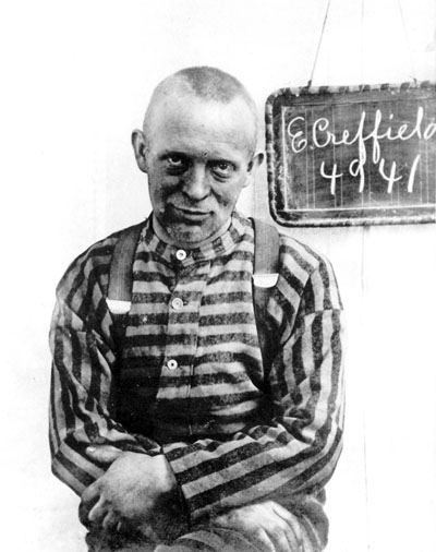 "A jailhouse mugshot of F. Edmund Creffield, founder of the Bride of Christ Church (""holy rollers"" or ""naked ladies cult"")"