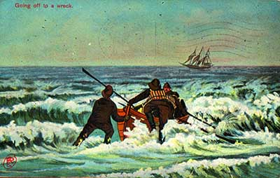 A vintage postcard image from the turn of the 20th century, showing a crew of rescuers launching a surfboat to go to the aid of a foundering schooner.