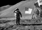 Commander Dave Scott salutes the U.S. flag, which has just been planted on the surface of the moon. A small piece of Oregon lava rock, carried to the moon by Scott's fellow astronaut Jim Irwin, lies within this photo, next to one of the many bootprints. (Image: NASA)