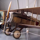 A French SPAD fighter plane parked in a museum. Chances are good this aircraft contains some Oregon spruce.